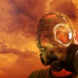 Man with gas mask and Clouds — Stock Photo