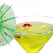 Closeup Green martini with an umbrella - Stock Photo