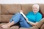 Happy senior with a book — Stock Photo