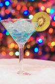 Ice christmas drink with a slice of kiwi — Stock Photo