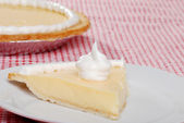 Banana cream pie with topping — Stock Photo