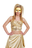 Blond woman in gold with hands on hips — Stock Photo