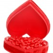 Candy cinnamon hearts in a red heart box — Stock Photo