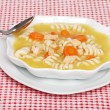 Chicken pasta soup with spoon — Stock Photo