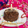 Chocolate birthday cake with decorations — Stock Photo