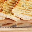 Closeup garlic bread with knife - Stock Photo