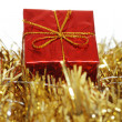 Closeup red present with gold bow — Stock Photo