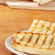 Garlic bread on a plate - Stock Photo
