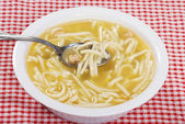 Chicken noodle soup with spoon — Stock Photo