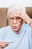 Closeup senior sick with fever — Stock Photo