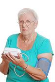 Senior woman blood pressure machine — Stock Photo