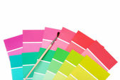 Color chips with paint brush — Stock Photo
