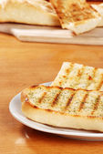 Garlic bread on a plate — Stock Photo
