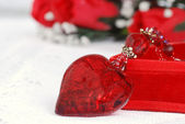 Macro red heart necklace — Stock Photo