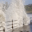 Sea crashing over railings — Stock Photo