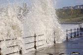 Sea crashing over railings — Stock Photo