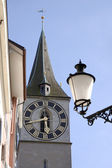 Clock face and street lamp — Stock Photo