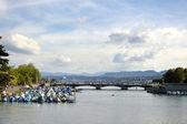 Zurich river boats and bridge — Stock Photo