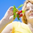Woman with cherries — Stock Photo