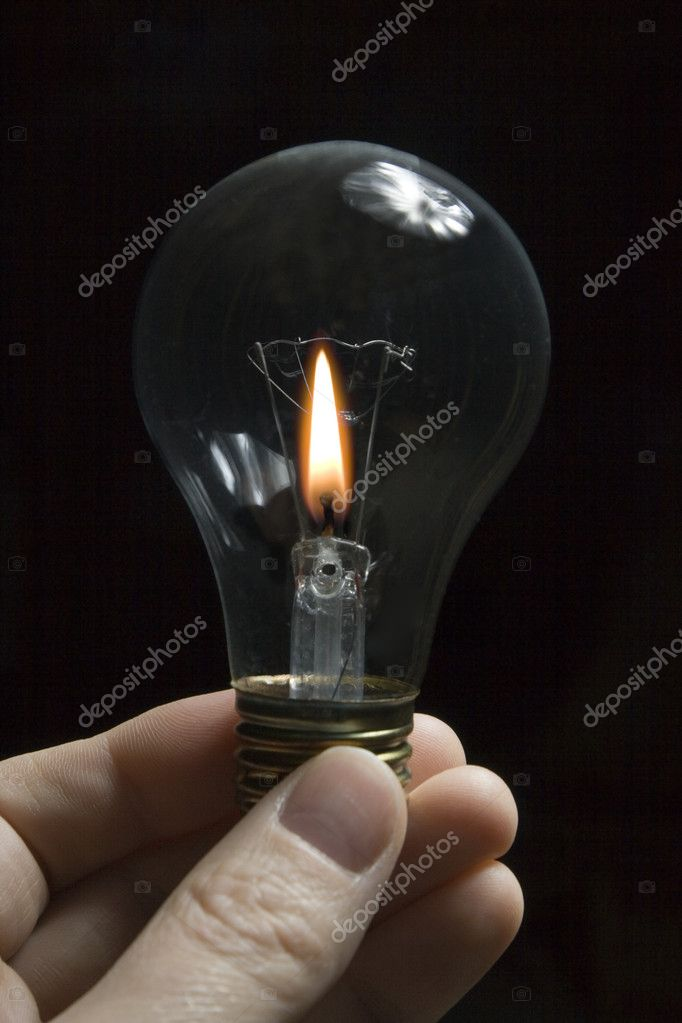 Candle flame inside of a light bulb. — Stock Photo #2451661