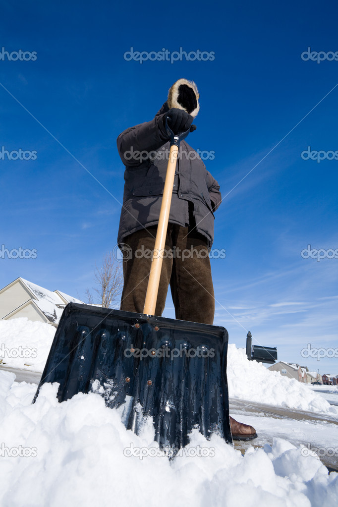 Man is shoveling snow from the driveway — Stock Photo #2554440