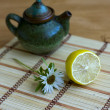Stock Photo: Teapot and lemon