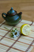 Teapot and lemon — Stock Photo