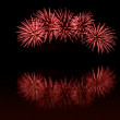 Red fireworks on a black sky - Stock Photo