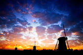 A silhouette of Dutch windmills — Stock Photo
