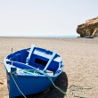 A blue boat on the beach — Stock Photo