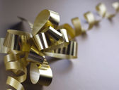Gift golden ribbon — Stock Photo