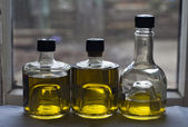 Three bottles of olive oil — Stock Photo