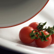 Cherry tomatoes on a plate — Stock Photo