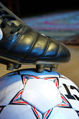 Ball and a football boot — Stock Photo