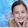Pretty girl swimming — Stock Photo