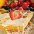Waffles with vanilla cream and fruits — Stock Photo