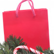 Red shopping bag with fir and candy — Stok fotoğraf