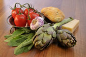 Artichoke and mediterran ingredients — Stock Photo