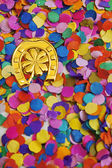Luck bringer and confetti — Stock Photo