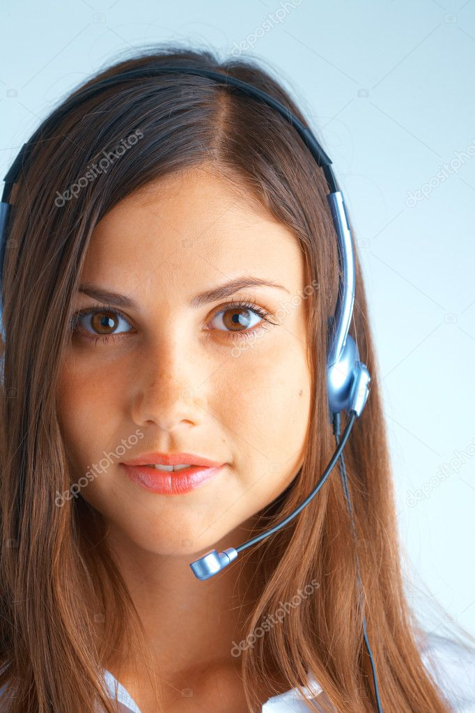 Young beautiful woman with headset with some at the background — Stockfoto #2659062