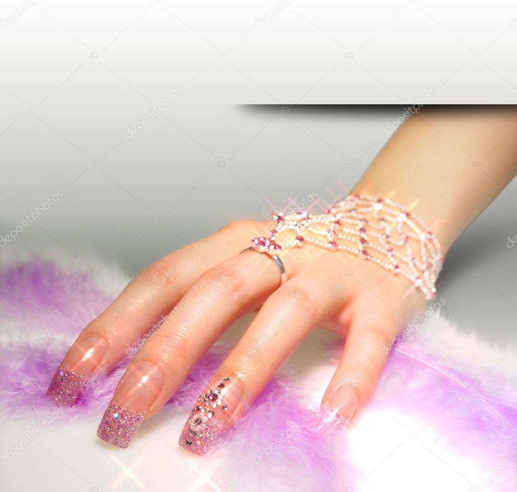 Beautifil female hand with strasses — Stock Photo #2387928