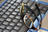 Glasses on a laptop — Stock Photo