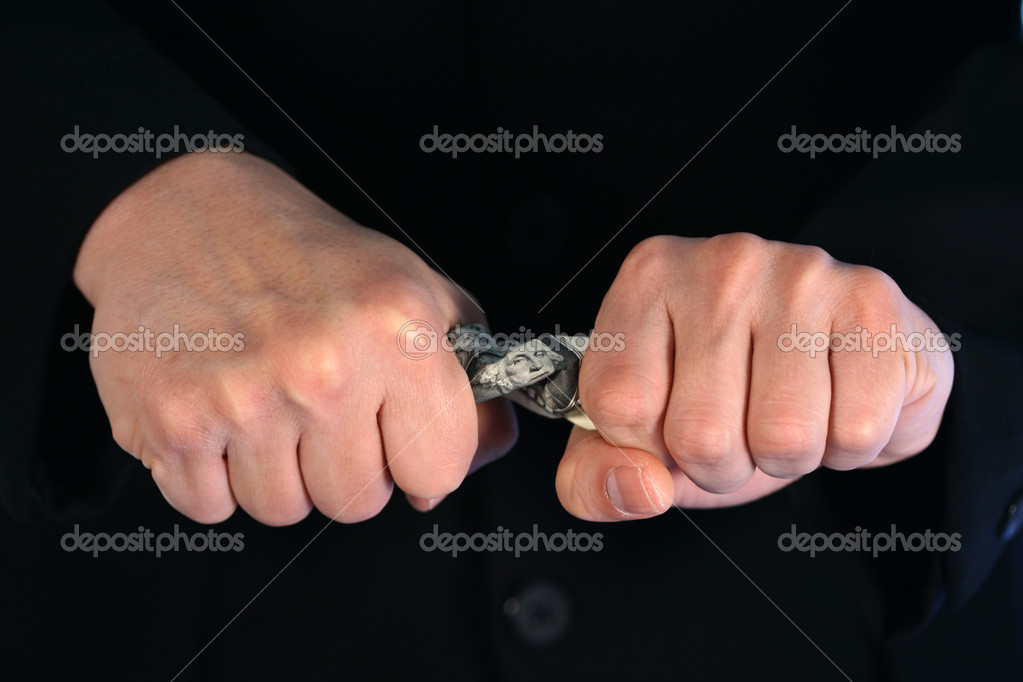Businessman trying to save money  Stock Photo #2382780