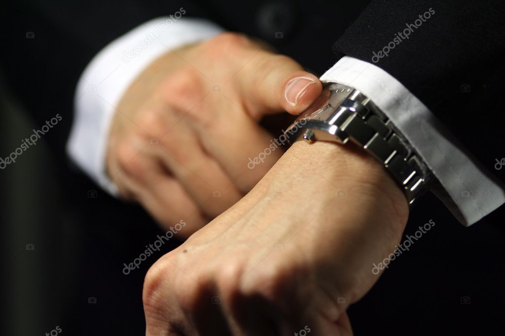 A businessman looking at his watch, deadline/due theme — Stock Photo #2383057