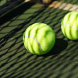Tennis balls in court — Stock Photo
