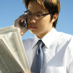 Reading businessman — Stock Photo