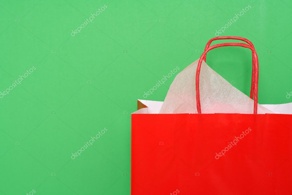 Red shopping bag on green background — Stock Photo #2587114