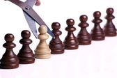 Chess pawns in danger — Stock Photo