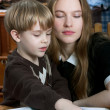 Stockfoto: Mother and son reading book