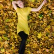 Beautiful woman - yellow autumn leaves — Stock Photo